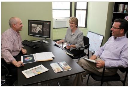 Pictured from left to right: Tom Lucia, Director of Annual Giving; Melinda Buckley, Chief Financial Officer; David Kersten, Chief Executive Officer